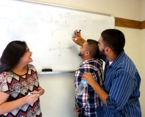 Laughter is part of the lab community for Angela Avitua, Rafael Ordaz, and Haroon Shafique.